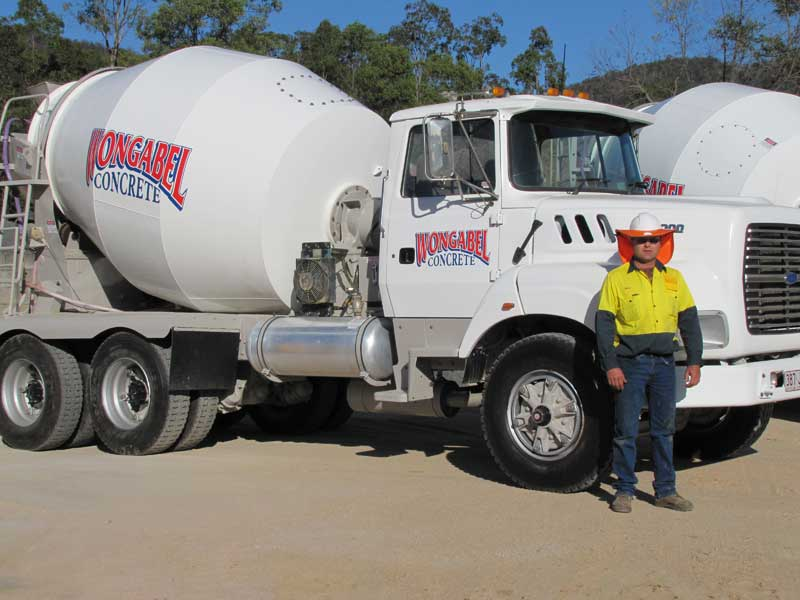 Concrete Plant Manager, Peter Green (Greeny), alongside one of our Concrete trucks