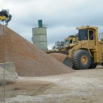 Loader in action, taking product from stockpile to load for cartage to customer